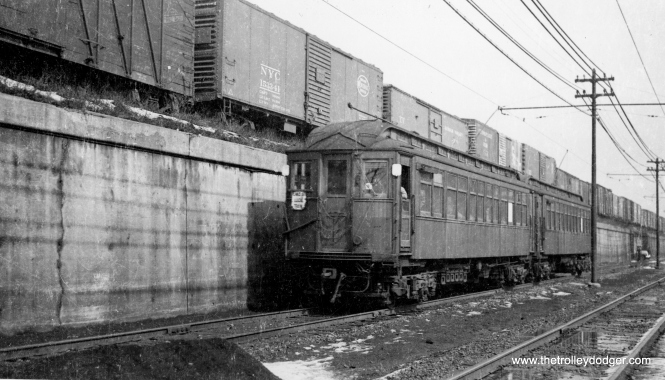"This is a Lake Street local train, heading west on the ground level section, which was elevated in 1962. Since this photo predates A/B ""skip stop"" service, it must date to before April 5, 1948. (George Trapp Collection)"