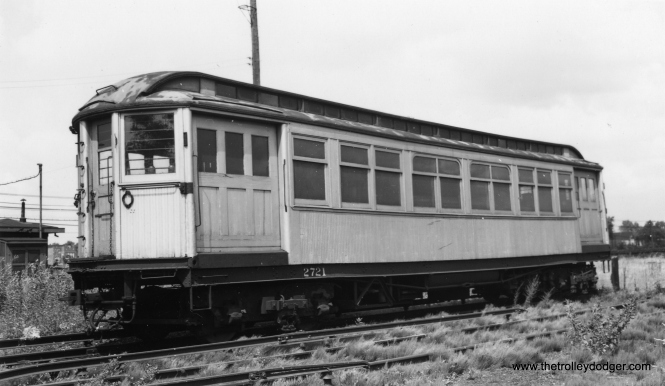 "Don's Rail Photos says, ""2721 was built by Barney & Smith in 1895 as Metropolitan-West Side Elevated Ry 721. In 1913 it was renumbered 721. In 1919 it was rebuilt as a merchandise dispatch car to be leased to the North Shore line. After a short time it was replaced by new and similar MD cars built for the North Shore. It was then returned to the CRT and used in work service. It became CRT 2721 in 1923."" The location is likely Laramie Yard. (Joe L. Diaz Photo, George Trapp Collection) We ran a different picture of 2721 in our post Chicago Rapid Transit Photos, Part Four (September 20, 2016)."