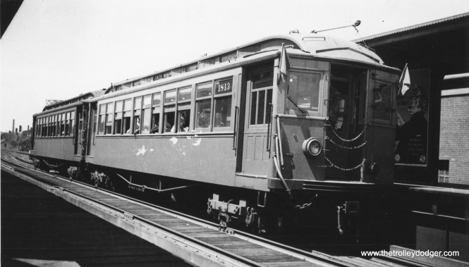 CRT 1813 is part of a two-car train at Sedgwick. The flags may indicate this was a fantrip. (George Trapp Collection)