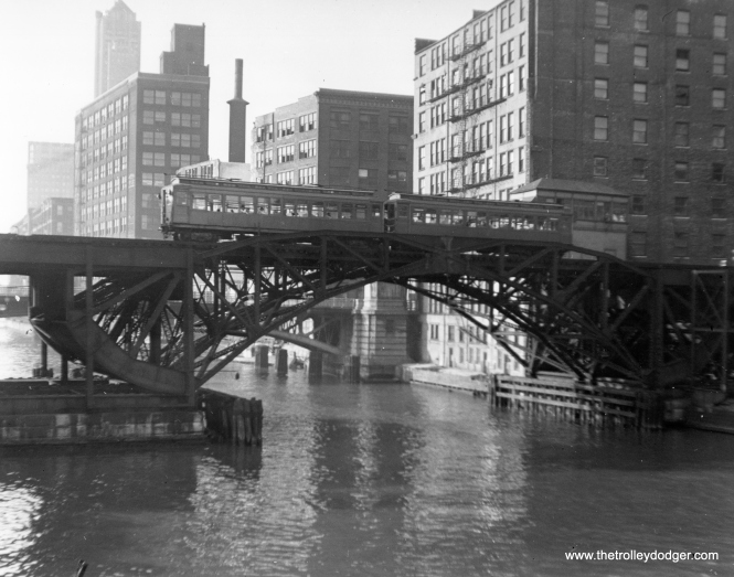 "A two-car Met ""L"" train crosses the Chicago River just west of the Loop in July 1951."