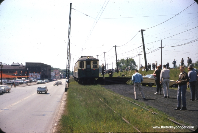 On May 26, 1963, a Central Electric Railfans' Association fantrip train makes a photo stop on the CTA team track at South Boulevard in Evanston. This train consisted of 4259-4260 and 4287-4288. By this time, the 4000-series cars, which were originally designed to operate individually as well as in multiple units, were being used as semi-married pairs.