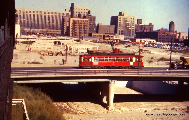 In the latter days of streetcar service on Halsted (1953-54), PCCs were replaced by older red Pullman streetcars such as this one. More progress has been made building the highway, as compared with the previous pictures.