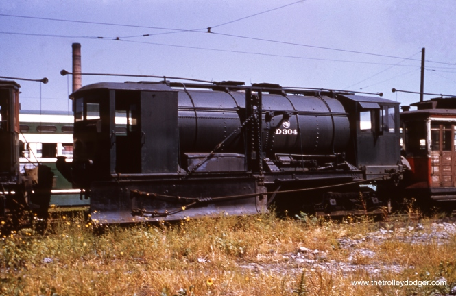 CTA D-304, a sprinkler converted into a snow plow, shown at 77th and Vincennes in September 1951.