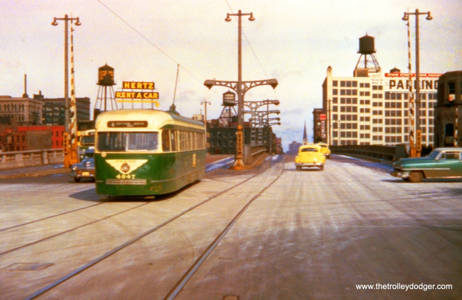 CTA 4047 crossing the Chicago River at State Street on December 7, 1953. This is a route 4 - Cottage Grove car.