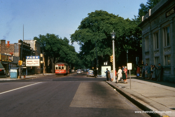 Here, we see CTA 1745 at Lake and Austin, the west end of route 16, on June 15, 1952. In this view, looking east from suburban Oak Park, the Park Theatre is still in business. By the time streetcar service ended here in 1954, it had closed.