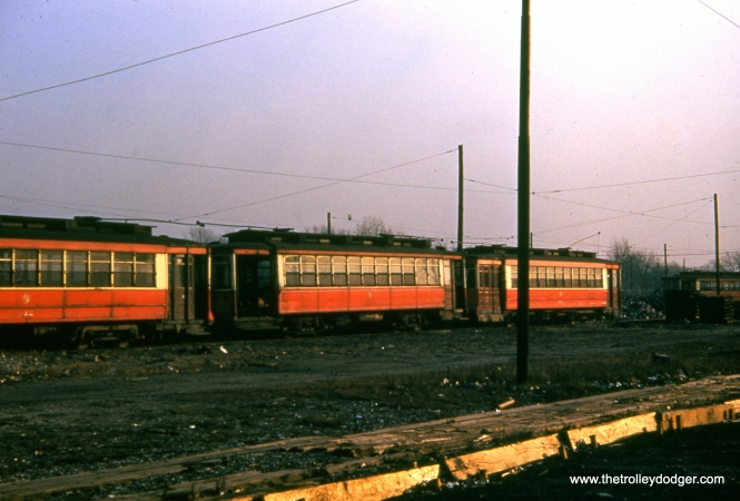Among these red cars at 77th and Vincennes, we see CTA Pullman 142 at left in November 1949.