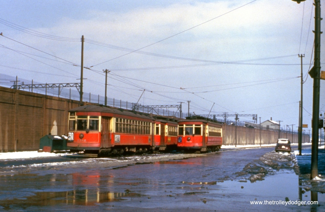 CTA 3182 and 660 at Cottage Grove and 115th in December 1951. This was the south end of route 4. The Illinois Central Electric is up on the embankment.