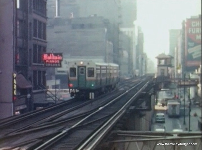 A two-car CTA Ravenswood train approaches Adams and Wabash in 1963.