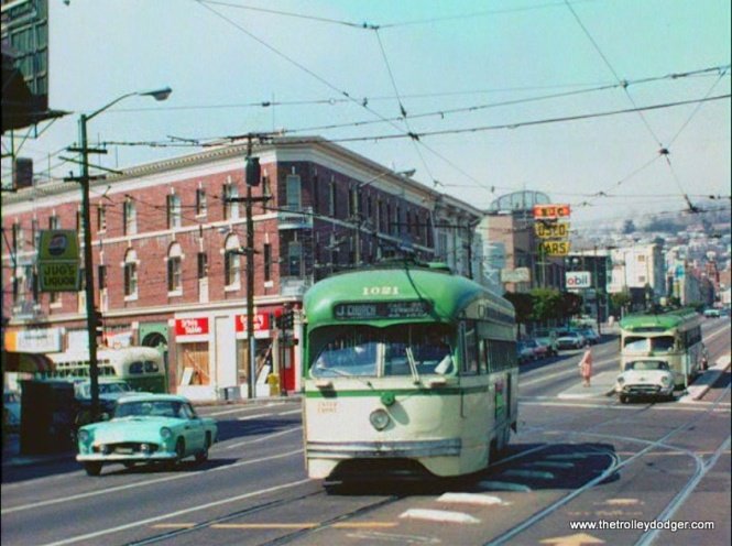 SF Muni PCC 1021 and a 1955-57 two-seater Thunderbird roadster.