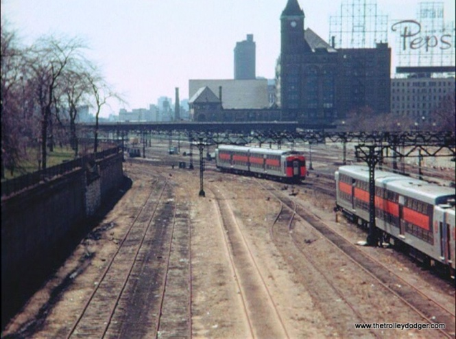 Illinois Central bi-levels in Chicago, with the old Central Station in the background.