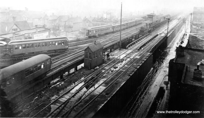 "M. E. says this is ""the view facing west at Indiana, again while the Kenwood line was a through line."" George Trapp: ""The center-door steel car is a loop-bound Kenwood train, shown at the junction with the main South Side ""L"". The 4-car train is a north-south through train. The wood train about to cross in front of the Kenwood train is probably a Loop-bound Englewood train."" The tracks at right were used for freight. This photo was taken from the roof of the building shown on the left of the next picture that follows. Contrast this with a photo taken circa 1955-57 at much the same spot in our previous post Chicago Rapid Transit Photos, Part Three (March 23, 2016). (George Trapp Collection)"