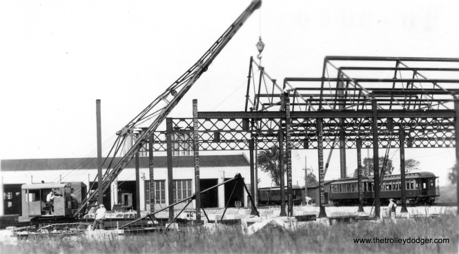 "Construction at Skokie Shops. By comparing this photo to a similar one on Graham Garfield's web site, we can date this to about 1930. George Trapp: ""Construction at Skokie (Niles Center at time of photo) is late 1920's or early 1930's. Wood cars at right are in CRT Green and Orange scheme."" (Allen T. Zagel Photo, George Trapp Collection)"