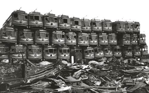 Pacific Electric Railway streetcars stacked at a junkyard on Terminal Island, March 1956.