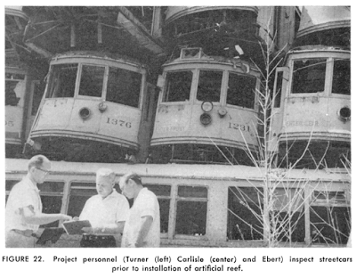 Marine biologists inspect the street cars to be used in artificial reef pilot projects in 1959. (Photo, Artificial Habitat in the Marine Environment, Department of Fish and Game, University of California, 1964)