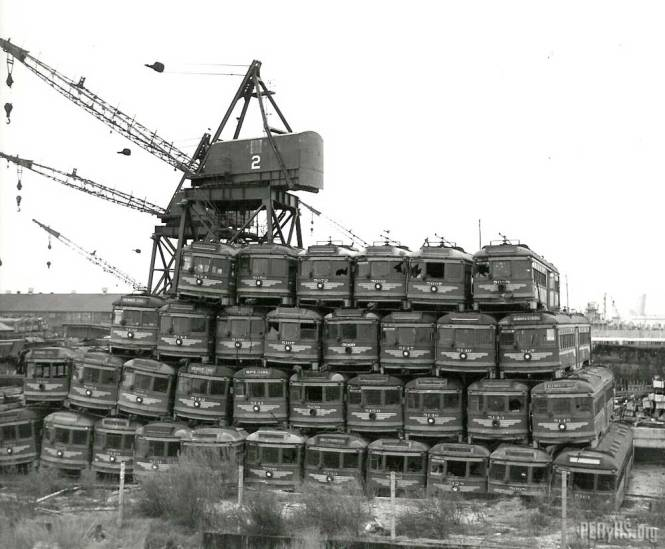 Abandoned former Pacific Electric streetcars get piled high at the Terminal Island scrapyard in the 1950s. (Jack Finn Collection)