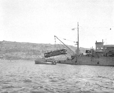 A U.S. Navy salvage ship lowers an unknown trolley or streetcar into the Pacific off Redondo Beach / Palos Verdes in September 1956. (Photo, Artificial Habitat in the Marine Environment, Department of Fish and Game, University of California, 1964)