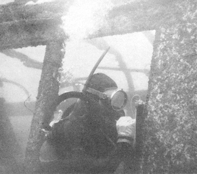 Marine biologist Charles H. Turner inspects a submerged trolley in the South Bay, July 1959. (Photo, Artificial Habitat in the Marine Environment, Department of Fish and Game, University of California, 1964)