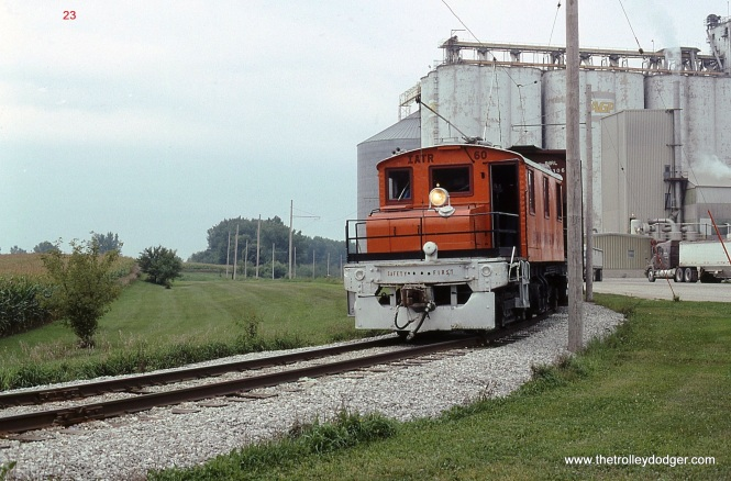 23. August 25, 2006 was grey and overcast in Mason City but the sight of a 1917 built steeplecab electric locomotive in revenue service sure brighten up the day. Cloudy weather afforded the opportunity to get a shot of # 60 leaving AGP from the opposite side.