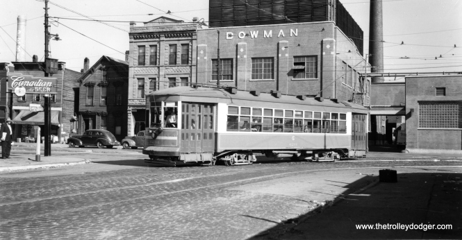 "Here, the caption reads, ""43rd-Root. Westbound car 3280, about to cross Halsted Street to reach its west terminal at the Stock Yards. This line competed with the Stock Yards ""L"" and lasted until 1953."" Andre Kristopans adds, ""3280 turning from nb State into wb Root. Old Bowman dairy bldg still there."" (Joe L. Diaz Photo)"