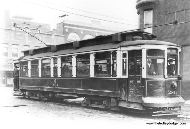 "CSL 2813 on the Hammond, Whiting, and East Chicago line, which was jointly through-routed by both the Surface Lines and the aforementioned Indiana operator. Streetcar service was eliminated on this line in 1940, but this picture looks older than that. Bill Shapotkin: ""This picture (of which I have a copy myself) was taken in Exchange (JUST EAST of Indianapolis Blvd) looking west in East Chicago. Note the ""Y"" in the wire behind the car. As an aside, the tracks in Exchange are still in-place. David Stanley and I JUST HAPPENED to visit here when Exchange was being repaved. The pavement was removed up to the railhead -- with the rails left in-place and (within a few days) paved over AGAIN."""