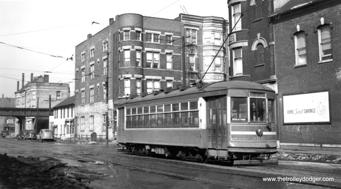 "CSL 3106. But which line is this, and which ""L"" is in the background? It's hard to make out for sure, but the side sign may say 18th Street. Patrick writes: ""CSL 3106 is on Leavitt, northbound, at 21st Street. The buildings are still there. The Douglas L is in the background."" (Joe L. Diaz Photo)"