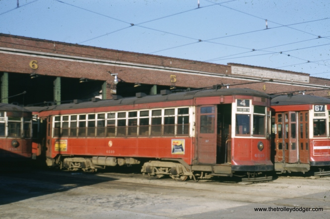 "This photo of CTA streetcar 6149 was taken from an original red-border Kodachrome, which identifies the location as the ""Campbell Avenue barn yard."" However, to me it looks like 69th and Ashland. The slide mount is of a type used by Kodak between 1950 and 1955. I would say this is closer in date the the former."