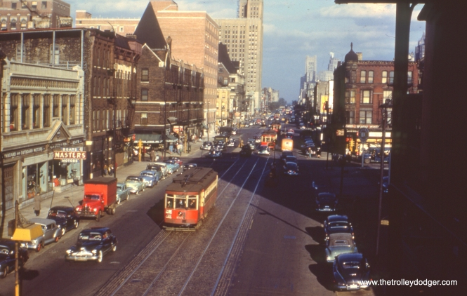 "It's June 10, 1951, and CTA red Pullman 230 is heading west on Chicago Avenue in this view taken from the Ravenswood ""L""."