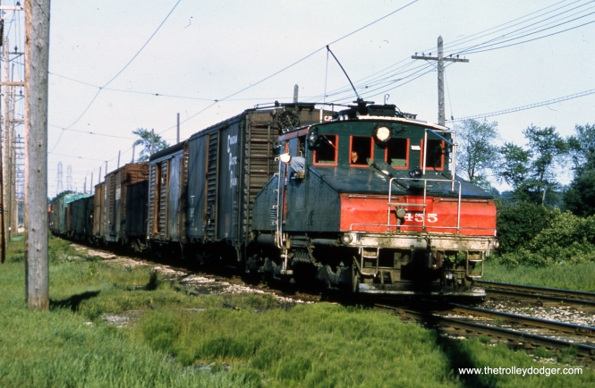 It's June 1962 at Rondout, and we see a North Shore Line freight train, headed up by electric loco 455.