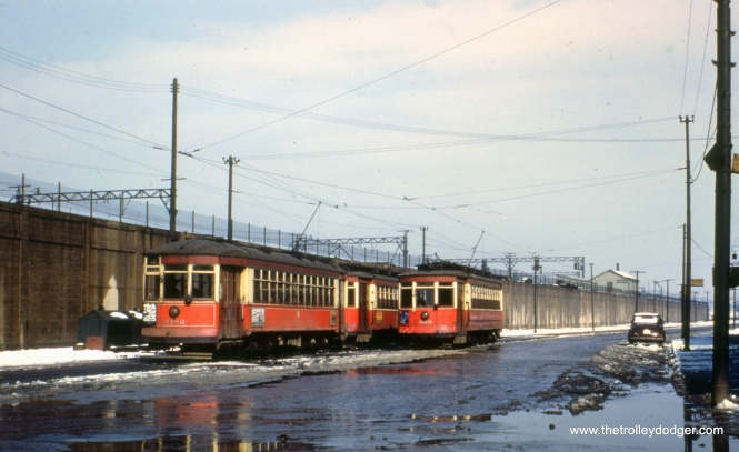 Here, we are at Cottage Grove and 115th, the south end of route 4. CTA red cars 3182 and 660 are visible. The date given is December 1952, but some might argue for an earlier date than that since there are no PCCs in sight here. The line ran parallel to the Illinois Central Electric suburban service embankment.