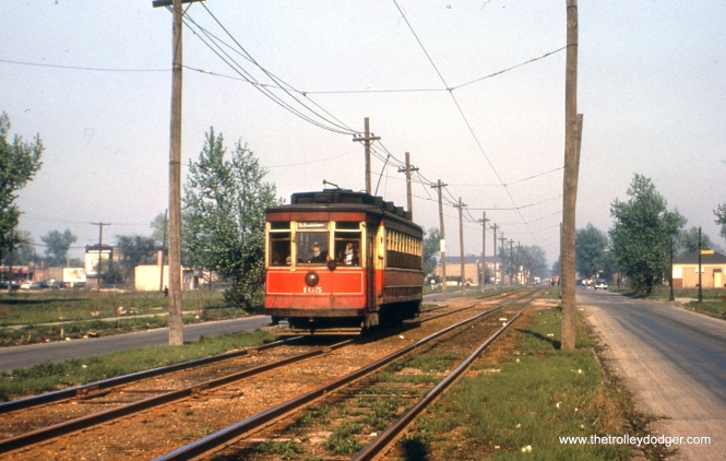 Here, we see CTA red Pullman 165 heading west on the private right-of-way portion of the 63rd Street route, a few blocks west of Central Avenue. The date is given as August 17, 1951, although some might argue for 1952 instead. These tracks ran in 63rd Place, which is now a completely built-up residential area a short distance south of 63rd Street.