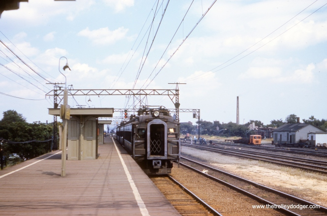 "This picture of a 1926-vintage Illinois Central Electric suburban train was taken on September 9, 1959. I am not sure of the location, but it is marked as a Randolph Street Express, and the smokestack at right belongs to a laundry. Service continues today under the aegis of Metra Electric with modern bi-level cars. David Vartanoff writes: ""The IC Electric pic is likely Kensington. Look at extreme magnification and one sees the r-o-w expand to 4 tracks."" Jack Ferry adds: ""The IC Suburban Train is heading northbound at 115th St. Kensington."" This would be the same station near where the CTA route 4 - Cottage Grove streetcar ended. That was the site of many pictures over the years.(Clark Frazier Photo)"