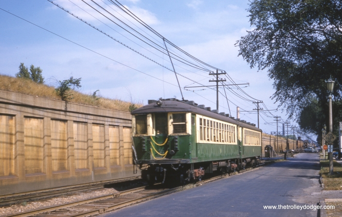"In this September 14, 1960 view, we see a pair of CTA 4000s heading east on the ground-level portion of the Lake Street ""L"", running alongside South Boulevard just west of Oak Park Avenue in suburban Oak Park. Just over two years later, this portion of the line would be relocated to the adjacent Chicago & North Western embankment, where it continues to run today as the Green Line. (Clark Frazier Photo)"