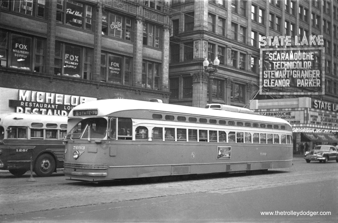 CTA 7093 is southbound on State Street near Lake, as a route 36 Broadway-State car. The film Scaramouche, playing at the State-Lake, was released on June 27, 1952, so that is the approximate date of this picture. Note a Chicago Motor Coach Company bus at left. The State-Lake opened in 1919 and closed in 1985. It was taken over by WLS-TV for use as a studio. (Walter Hulseweder Photo)