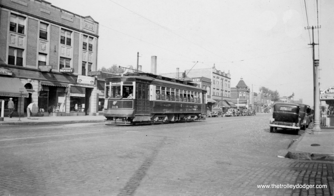 CSL Pullman 318 is heading west on Fullerton in the mid-1930s picture. At right, you can just make out the marquee of the old Liberty Theatre, which opened in 1911 and closed in 1951. The building is now a banquet hall. Will Rogers' name is on the marquee. The photo date is given as September 8, 1937 and I guess that is possible although Rogers died in August 1935.