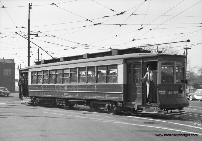 CTA red Pullman 225 is shown here on a mid-1950s fantrip at the 77th Street Shops. The big man at front is Maurice Klebolt (1930-1988), who organized many such trips for the Illini Railroad Club. He later moved to San Francisco and helped start the historic trolley festival there. Car 225 is preserved at the Seashore Trolley Museum in Maine. (Chuck Wlodarczyk Photo)
