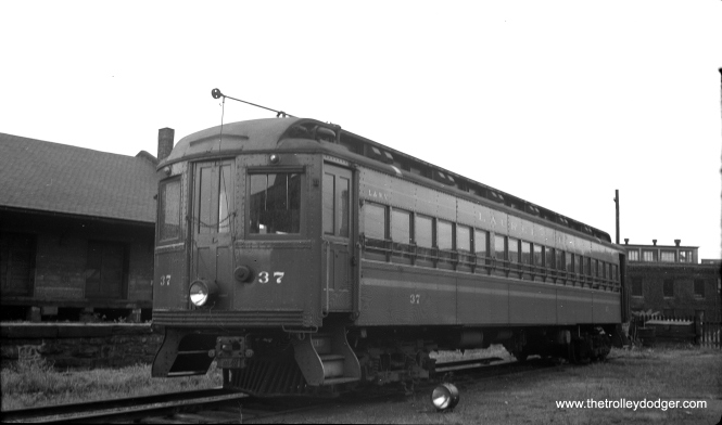 "The Lackawanna & Wyoming Valley (aka the Laurel Line) was a Scranton-area interurban powered by third rail, much as the Chicago, Aurora & Elgin was. Here, we see coach #37 in Scranton on September 9, 1950. The line quit at the end of 1952. There were no takers for these cars and all were scrapped. It has been suggested that perhaps CA&E might have benefited from buying some of these cars, although it does seem they were too long for tight turns on the Chicago ""L"". However, I do not know if this would have prevented them from running on the CA&E after the system was cut back to Forest Park. In any case, CA&E had previously reduced the length of other cars purchased from the Baltimore & Annapolis in 1938. What was missing in 1953, apparently, was a willingness to continue trying to operate."