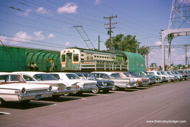 This picture, showing a Skokie Swift single car unit at the Dempster terminal, was taken on August 11, 1964. We see an interesting variety of 1960s cars in the parking lot, including a first-generation Corvair. The slide says this is car #30, but under magnification, the number looks more like 39. However, as far as I know, car 39 was then being used in Evanston service with trolley poles. So perhaps 30 is correct. That car is preserved at the Illinois Railway Museum. (Douglas N. Brotjahn Photo)