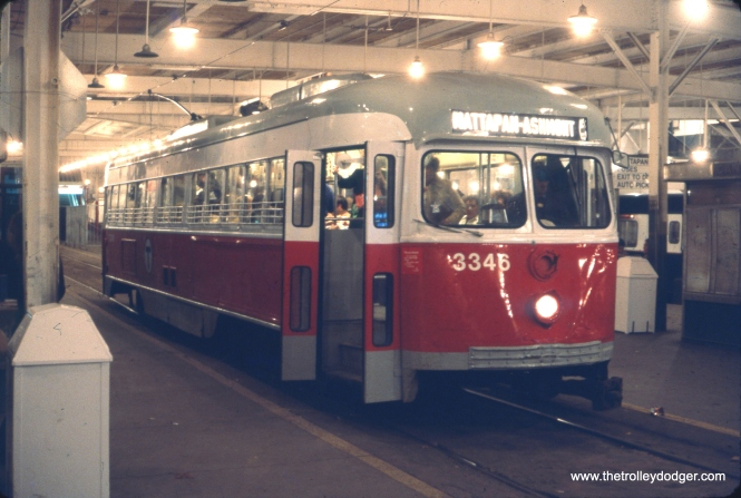 "Here, we see MBTA (Boston) double-end PCC 3346 at the Ashmont end of the Ashmont-Mattapan line in November 1977. This picture has special significance to me, as I rode these cars for the first and only time just three months earlier. They were nearing the end of their service lives, however, and by the time I revisited, had been replaced by single-ended PCCs. Over time, the terminals at both ends of this feeder line have been changed, and I don't believe the cars run here any longer. I recall there was a sign somewhere in the vicinity, probably from the 1920s, calling this the ""High Speed Trolley."" I hope someone managed to save that sign."