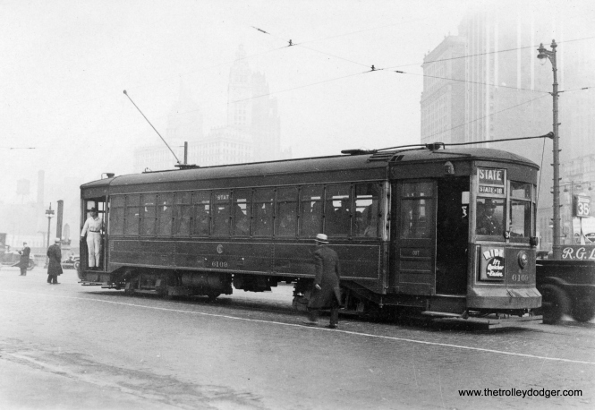 "On a foggy day in December 1932, we see CSL ""maximum traction"" car 6109 southbound at State and Wacker."