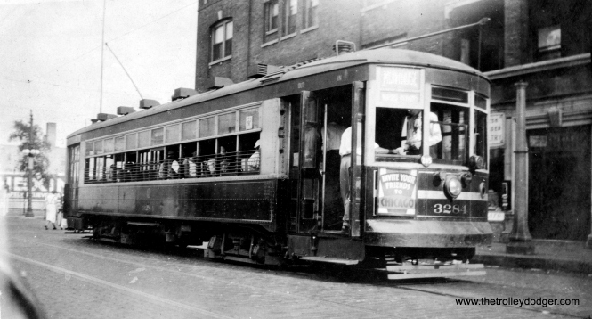 "Caption: ""Chicago Surface Lines #3284. i man car built by Lightweight Noiseless Car Co. in 1925. Taken: Chicago, Ill., 8-4-34. Former two-man (car) also in MU (multiple unit) service. Now equipped with stop light and foot brakes."" The car is shown at the east end of the Montrose line, just west of Broadway. (Earl W. McLaughlin Photo)"