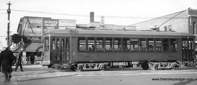 "Chicago and West Towns car 156 on 22nd Street (or was it already called Cermak road) in Cicero, 1936. The car is heading west and we can just see a glimpse of the Douglas Park ""L"", which runs just north of Cermak. The car is signed to go to Riverside. Don's Rail Photos: ""156 was built by Cummings Car Co in 1927. It was rebuilt in 1942 and scrapped in 1948."""