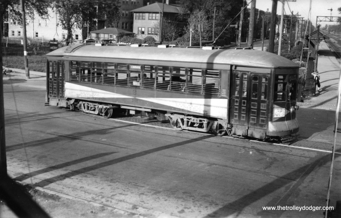 "Don's Rail Photos says Chicago & West Towns car 106 ""was built by McGuire-Cummings in 1915. It was dismantled in 1943."" Here, we see it heading north on Harlem and Stanley in 1936, having just crossed the Burlington RR."