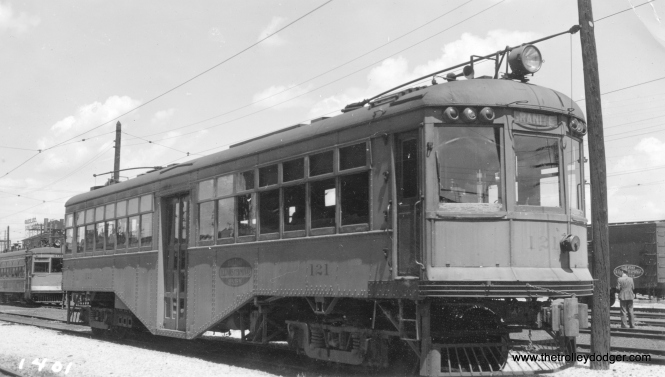 "Illinois Terminal car 121, as it appeared at Granite City on June 7, 1936. It was then being used in local service on the route between St. Louis and Alton. Don's Rail Photos adds, ""121 was built by East St Louis & Suburban in 1924 as 5. It became StL&ARy 5 in 1930 and IT 121 in January 1931. It was sold for scrap to Hyman Michaels Co on July 23, 1953."" (Glenn Niceley Photo)"