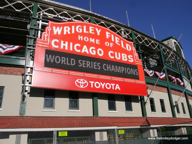 "After the Chicago Cubs won their first world championship since 1908, the Chicago Transit Authority put a special ""wrap"" on one bus (I think the number is 8305) for a limited time, and ran it on Addison, which passes right by Wrigley Field. The following two pictures were taken there on November 9, 2016. Bill Shapotkin adds, ""While the Cub's victory was the first in 108 years, it was also the first since moving to Wrigley Field (formerly Weegman Park). When the Cub's won the 1908 series, they were still playing on the West Side grounds (roughly Wood/Polk, if I recall the location correctly)."" Yes, that is also where games for the 1906 WS between the Cubs and White Sox were played (the Sox won, 4 games to 2). Legend has it there was an insane asylum located near West Side Grounds, which is supposedly the origin of the expression, ""from out of left field."""