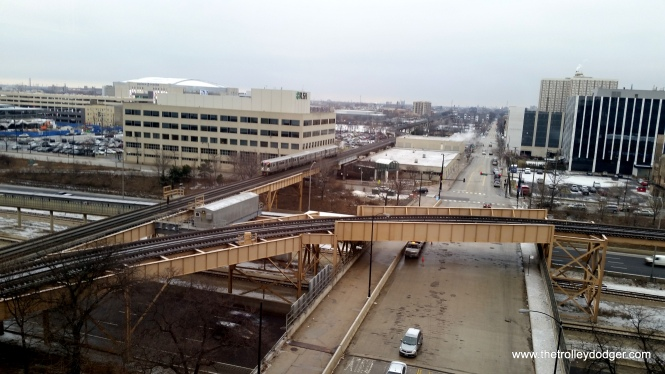 A southbound Pink Line train about to cross over the Blue Line.