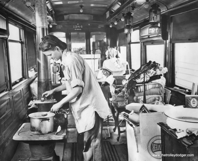 "Over-Age Streetcar Becomes Family's Home (April 16, 1946): Chicago- Mrs. Edith Sands prepares dinner on the small stove in the over-age streetcar where she and her husband, Arthur, and their five-months-old son, Jimmy, have just moved. The trolley car, which has seen nearly 50 years of service on Chicago streets, was purchased by the Sands at a recent public sale and propped up on a 5-acre site near Chicago's southern edge. The car is lighted by gasoline lamps. (Editor's Note: You can see the car number (1384) in this picture. This was part of the same series as the ""Matchbox"" 1374 that has been restored to running condition at the Illinois Railway Museum. The bodies of a couple other cars in this series have been found over the years and saved.)"