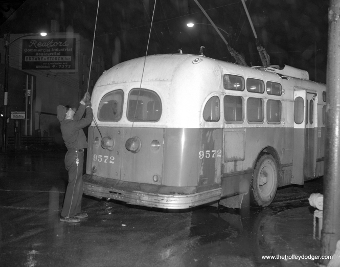 On January 23, 1965, the operator of CTA Marmon trolley bus 9572 has to get out at Grand and State and put the poles back on the wires. This was an occasional occurrence that CTA riders of a certain age will probably remember.