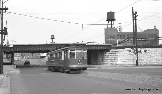 CTA Pullman 144 is heading southwest on Archer approaching Wentworth on June 15, 1958. This was four years after red cars were retired from active service, and less than a week before the end of all Chicago streetcars. The occasion was a fantrip sponsored by the Electric Railway Historical Society (ERHS). (Bob Selle Photo)