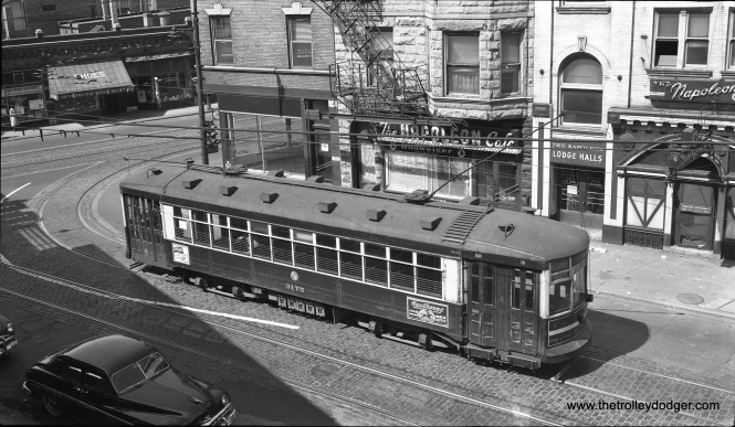 "On Sunday, September 13, 1953, CTA one-man shuttle car 3175 is on Fifth Avenue at Pulaski (Crawford), the west end of the Fifth Avenue line. This had been a branch line from route 20 - Madison. From this point, the cars looped via Pulaski and Harrison before going back NE on Fifth. The photographer was on the Garfield Park ""L"" at Pulaski. The ""L"" was heading east and west at this point, just south of where the Eisenhower expressway is today. This ""L"" station remained in use until June 1958. Streetcar service on Fifth Avenue continued into early 1954. The Fifth Avenue line used gauntlet track on Pulaski, so as not to interfere with Pulaski streetcars. This is confirmed by studying the 1948 supervisor's track map. Danny Joseph adds, ""As a child I lived near this triangle when both Pulaski and Fifth still operated street cars and Harrison did not. I was very fascinated by the gauntlet on Pulaski which was the first time I saw such construction."" (Bob Selle Photo)"