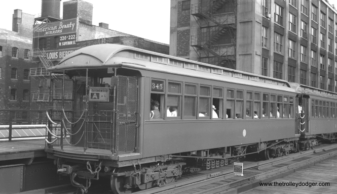 "On August 9, 1955 CTA wooden ""L"" car 345 is at the front of a northbound Ravenswood ""A"" train at Chicago Avenue. (Bob Selle Photo)"